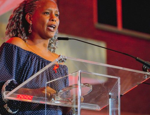 Hughes Honored with L. Joel Martinez Award on World AIDS Day
